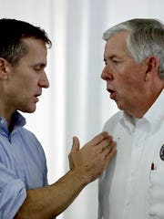 Then-Lt. Gov. Mike Parson, right, talks to then-Gov. Eric Greitens at the Missouri State Fair in 2017. Parson became governor in June 2018 when Greitens resigned amid multiple investigations into his conduct.