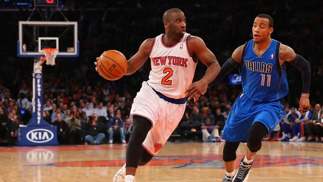 New York Knicks point guard Raymond Felton dribbles the ball in front of Dallas Mavericks shooting guard Monta Ellis during the third quarter at Madison Square Garden on Monday night.
