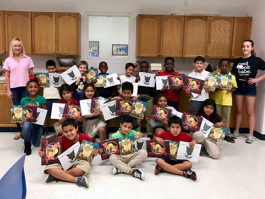BGC-Holiday-Book-Giveaway-by-O2---2nd-graders---Dottie-Withrow-and-Gerald-Hausman-Books---12-08-16---1.jpg