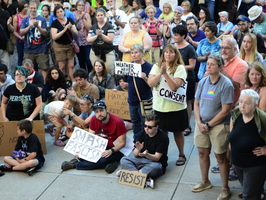 People gather in City Hall Park in Burlington on Sunday, Aug. 13, 2017, to hold a speak-out and vigil for Charlottesville, Virginia.