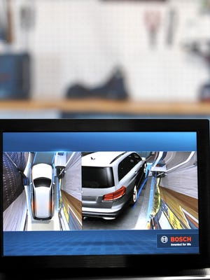This is a dashboard-mounted monitor where the driver can control the image view to help avoid potential, slow-moving collisions.