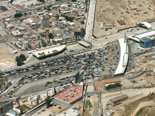 Traffic from Mexico backs up as vehicles approach the San Ysidro Port of Entry to enter California.