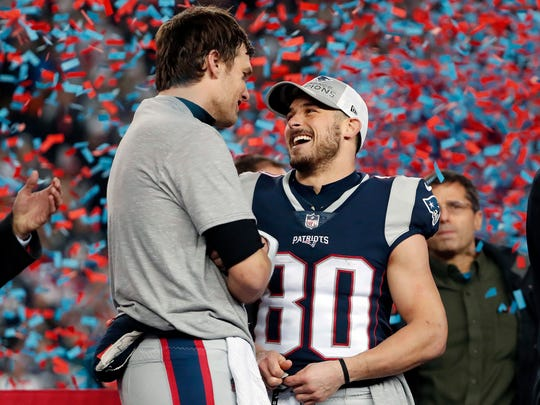 New England Patriots quarterback Tom Brady, left, speaks to wide receiver Danny Amendola after the AFC championship NFL football game against the Jacksonville Jaguars, Sunday, Jan. 21, 2018, in Foxborough, Mass. The Patriots won 24-20. (AP Photo/Winslow Townson)