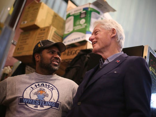 Former President Bill Clinton meets with supporters at NewBo Market on Thursday, Jan. 7, 2016, in Cedar Rapids, Iowa.