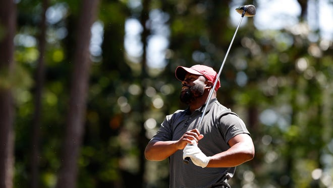 Mark Ingram tees off during the Chick-fil-A Peach Bowl Challenge at the Oconee Golf Course at Reynolds Plantation, Sunday, May 1, 2018, in Greensboro, Georgia.