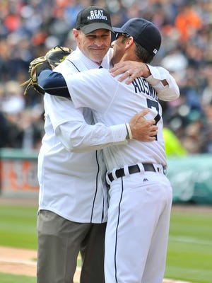 Kirk Gibson hugs Brad Ausmus after tossing out the first pitch for Friday's game.