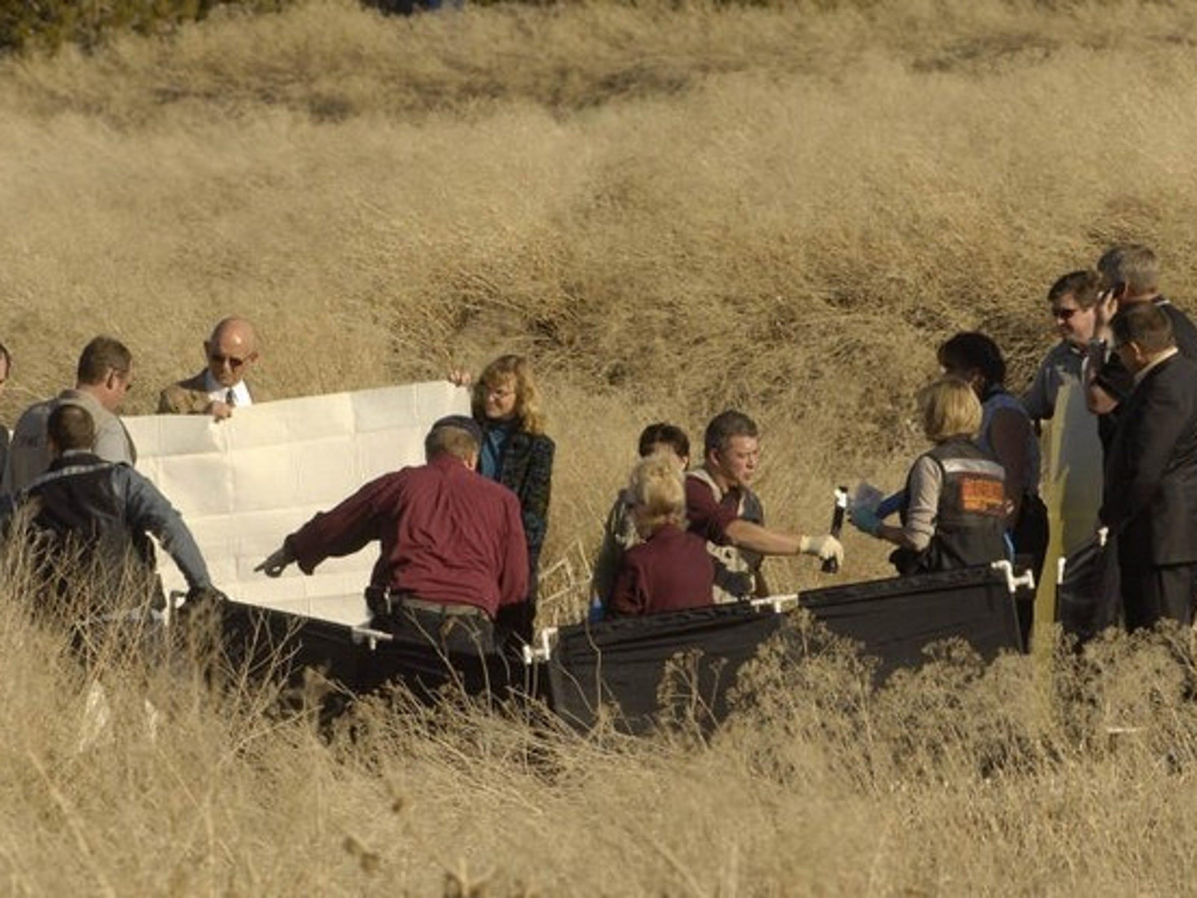 Investigators near Brianna Denison, who was found in a field in south Reno.