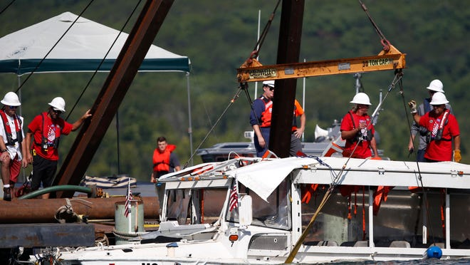 A duck boat that sank in Table Rock Lake in Branson, Mo., is raised July 23, 2018, after it went down the evening of July 19 when a thunderstorm generated near hurricane-strength winds, killing 17 people. A year later, the future of the tourist attraction remains a topic of debate.