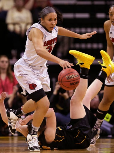 Louisville guard Tia Gibbs, left, grabs a loose ball over Iowa guard Samantha Logic during the second half of an NCAA tournament second-round women's college basketball game, Tuesday, March 25, 2014, in Iowa City, Iowa. (AP Photo/Charlie Neibergall)