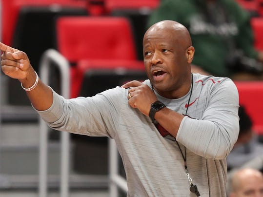 Arkansas head coach Mike Anderson signals during practice at the NCAA men's college basketball tournament in Detroit, Thursday, March 15, 2018. Arkansas plays Butler in the first round on Friday.  (AP Photo/Carlos Osorio)