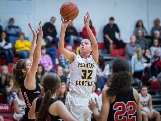Monroe Central's Abigail McGrath shoots past Sheridan's