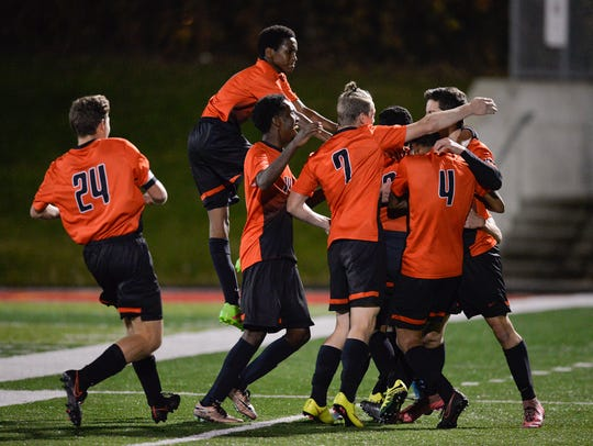 Moorhead players rejoice in their first goal of the