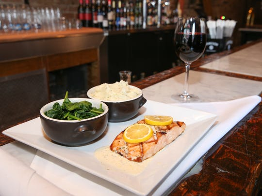 Grilled salmon on there menu at Kastel Bar & Restaurant
