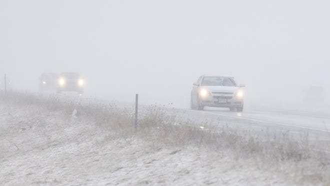 Vehicles travel westbound on State 23, Tuesday near Plymouth.
