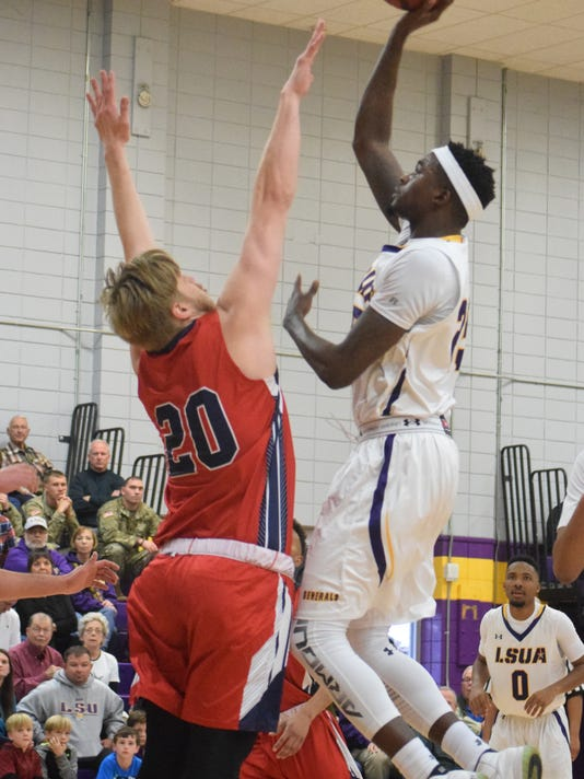 LSUA's Brian Sylvester (25, right) goes for two against the University of the Southwest defender Saturday at the Fort.