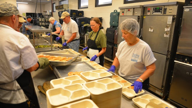 Volunteers pack up meals in Rockledge to be delivered throughout Brevard County for Aging Matters in Brevard's Meals on Wheels program.