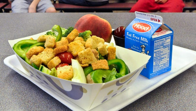 FILE - This Sept. 11, 2012 file photo shows a healthy chicken salad school lunch, prepared under federal guidelines, sitting on display at the cafeteria at Draper Middle School in Rotterdam, N.Y. A House committee has endorsed a GOP plan to allow some schools to opt out of healthier school meal standards. The vote comes as First Lady Michelle Obama has launched a campaign in support of the standards, holding a White House meeting this week.