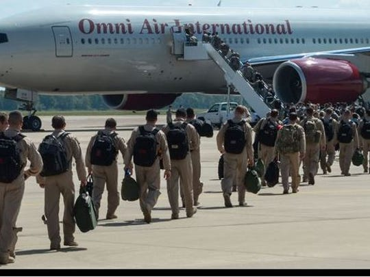 Barksdale Airmen board a plane to deploy from Barksdale