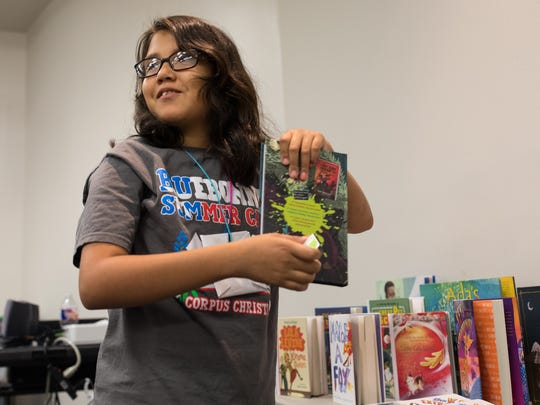 Mikayla Ozunq picks book to keep during Corpus Christi Independent School District and Corpus Christi Public Libraries summer reading camp on Thursday, July 20, 2017.