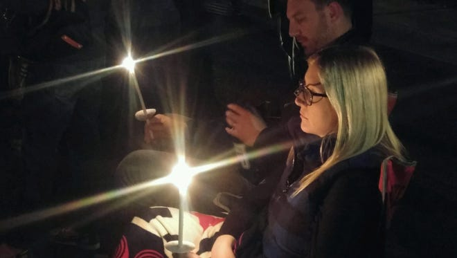 Megan Livingston, right, and her husband, Adam, were among the 50 attendees of a candlelight vigil for Allison Feldman. The event was held outside her Scottsdale home on Thursday, Nov. 13, 2015.