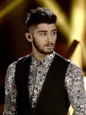 Zayn Malik of One Direction performs onstage during the 2013 American Music Awards at Nokia Theatre L.A. Live on November 24, 2013 in Los Angeles, California.