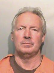 Steve Luebke, 57, was arrested after a single-vehicle crash.