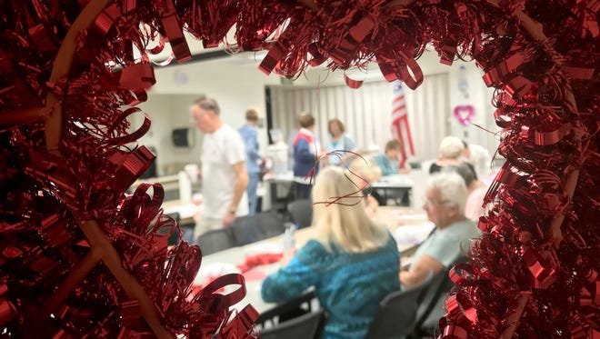 More than 30 volunteers in the America Supporting Americans effort write 550 Valentine's Day messages to troops overseas. The letter-writing event took place at the Goebel Adult Community Center in Thousand Oaks. A total of 1,500 valentines are being sent from Ventura County.