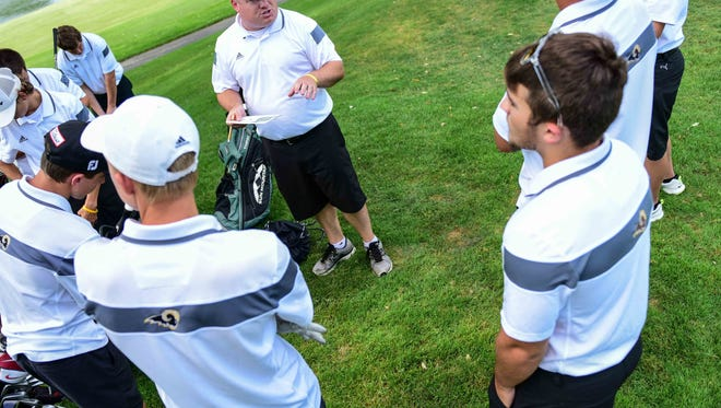Southeast Polk Coach Scott Powell gives his players final instructions Sept. 16, during a golf match between Urbandale boys golf team and Southeast Polk at Urbandale Golf and Country Club.