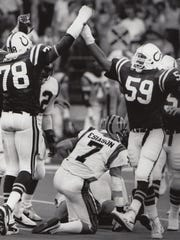 Colts John Hand (78) and Orlando Lowry (59) congratulate each other after sacking Bengals QB Boomer Esiason, Sept. 14, 1987