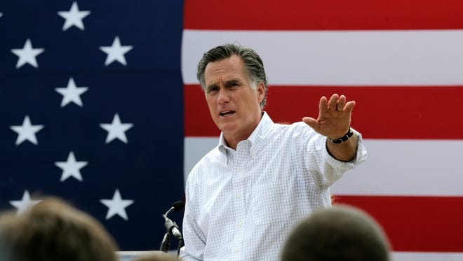 In this July 2, 2014, file photo, Mitt Romney, the former Republican presidential nominee, addresses a crowd of supporters while introducing New Hampshire Senate candidate Scott Brown at a farm in Stratham, N.H.  Romney told a small group of Republican donors that he's eying a third run at the White House. The GOP's last presidential nominee held a private meeting with prominent donors in New York on Friday, Jan. 9, 2015. He told the group he's seriously considering launching another presidential campaign.