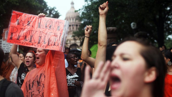 Hundreds of abortion rights demonstrators rally outside of the Texas State Captiol on July 15, 2013, to protest recent legislation that could shut down all but five clinics and restrict abortion rights throughout the state.