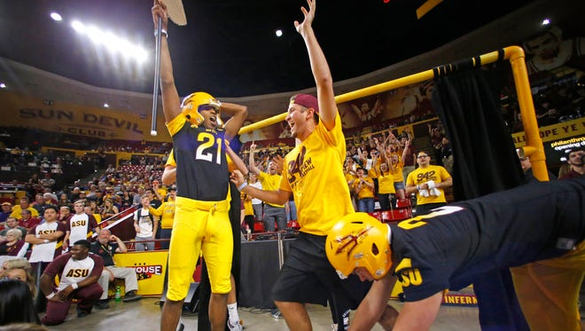 """Arizona State fans showcase their """"Curtain of Distraction"""" as the Arizona State Sun Devils host USC in their NCAA basketball game Sunday, Feb. 22, 2015 in Tempe,  Ariz."""