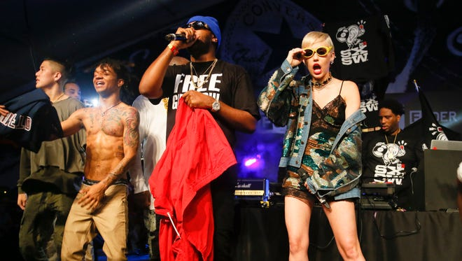 Miley Cyrus joins Mike Will Made It, center, and others onstage.