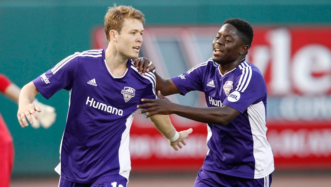 Louisville FC's Magnus Rasmussen (10) celebrates with Kadeem Dacres (7) after scoring a goal against OKC Energy FC during their game at Louisville Slugger Field in Louisville, Kentucky.         June 27, 2015