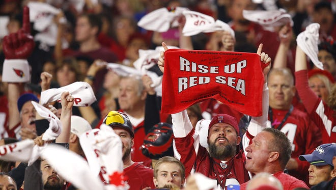 Arizona Cardinals fans cheer for their team as they host the Seattle Seahawks  in their NFL game Sunday, Dec. 21,  2014 in Glendale.