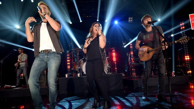 Musicians Charles Kelley (left), Hilary Scott and Dave Haywood of Lady Antebellum perform on The Honda Stage at the iHeartRadio Theater on June 29, 2015 in Burbank, Calif. The group has recently collaborated, on stage or in the studio, with EDM acts Zedd and Audien.