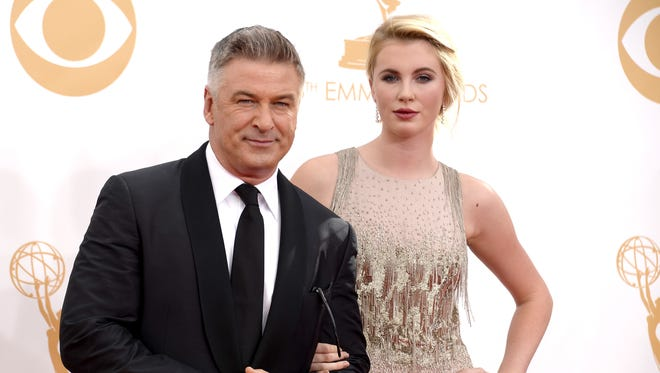 Actor Alec Baldwin (L) and daughter Ireland Baldwin arrive at the 65th Annual Primetime Emmy Awards held at Nokia Theatre L.A. Live on September 22, 2013 in Los Angeles, California.