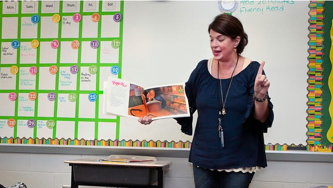 Erma Siegel Elementary School Sonya Cox reads a book in front of Melanie Brogli's fourth grade class during Reading at the Schools Day.