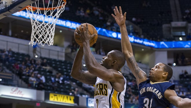 Indiana Pacers' Rodney Stuckey (2) goes to the basket with the ball as he's defended by New Orleans Pelicans' Bryce Dejean-Jones (31) during the second half of a preseason NBA basketball game Saturday, Oct. 3, 2015, in Indianapolis. The Pelicans won, 110-105. (AP Photo/Doug McSchooler)