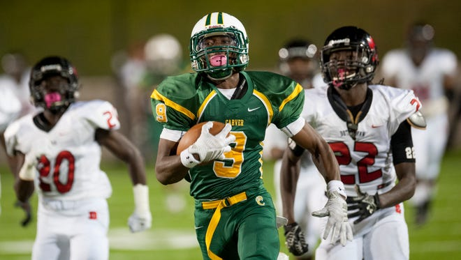 Carver's Xavier Lane (9) gains big yardage on a reception against Dothan at Cramton Bowl in Montgomery, Ala. on Thursday October 15, 2015.