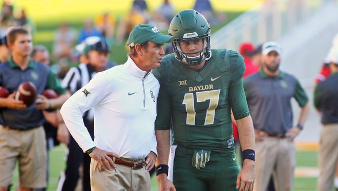 Baylor Bears head coach Art Briles and quarterback Seth Russell (17) prior to a game against the Lamar Cardinals at McLane Stadium.