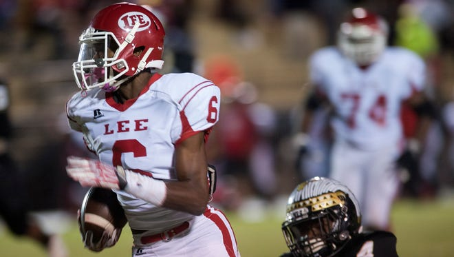 Lee's Henry Ruggs (6) carries for a long first half touchdown against Wetumpka's Robert Laprade (4) at Hohenberg Field in Wetumpka, Ala. on Friday October 30, 2015. (Mickey Welsh / Montgomery Advertiser)