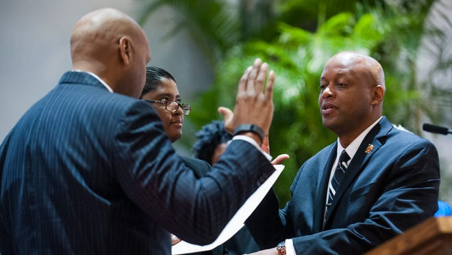 City Councilman William Green Jr. is sworn in during a ceremony at the council auditorium on Nov. 10, 2015.