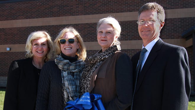 From left: Children of Dr. William Burrus, Beth Little, Sue Pinsly, Amy Flynn and Grady Burrus gather at the ribbon cutting of the new Dr. William Burrus Elementary School in Hendersonville on Dec. 17, 2015.