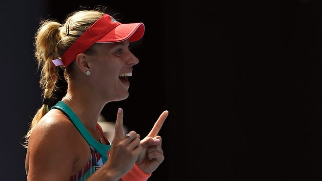 Angelique Kerber of Germany celebrates after defeating Johanna Konta of Britain in their semifinal match at the Australian Open tennis championships in Melbourne.
