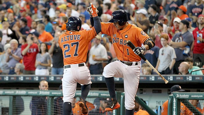 Carlos Correa, right, and Jose Altuve form an enviable middle-infield duo.