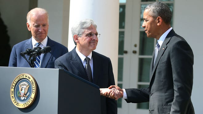 President Barack Obama shakes hands with Judge Merrick B. Garland, while Vice President Joe Biden stands nearby, after nominating him to the U.S. Supreme Court, in the Rose Garden at the White House on March 16, 2016 in Washington, D.C.