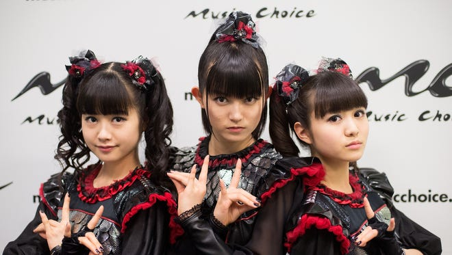 Moametal, Su-metal, and Yuimetal of the band Babymetal.