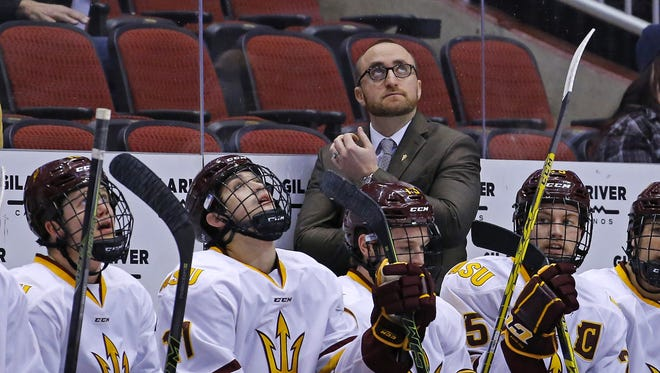 Arizona State Sun Devils head coach Greg Powers looks up to the scoreboard during the second period in the inaugural Desert Hockey Classic Sunday, Jan. 10, 2016 at Gila River Arena in Glendale, AZ.