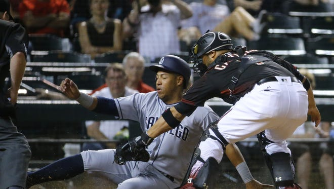 Arizona Diamondbacks catcher Welington Castillo (7) tags out San Diego Padres' Yangervis Solarte (26) in the 6th inning of their MLB game  Saturday, May 28, 2016 in Phoenix, Ariz.